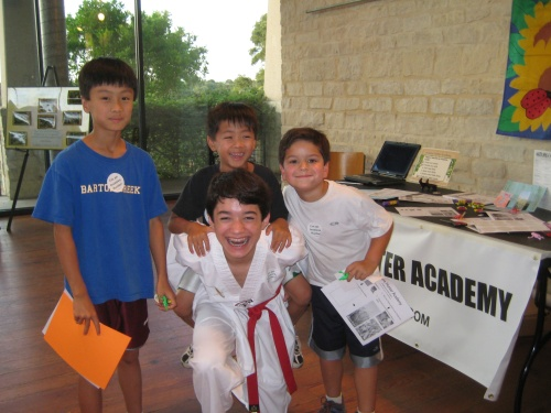 Commander Ben having fun with young Invasive Species Hunters last year at the Lady Bird Johnson Wildflower Center
