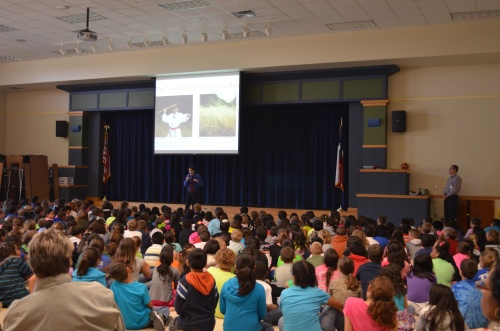 Commander Ben talks about invasive species to kids at the Rockdale Intermediate School in 2013