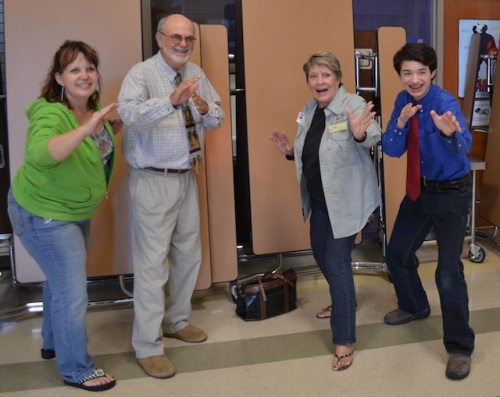Ms. Susan Boyd, Dr. John Pruett, Ms. Joyce Dalley, and Commander Ben show off their invasive hunter skills.