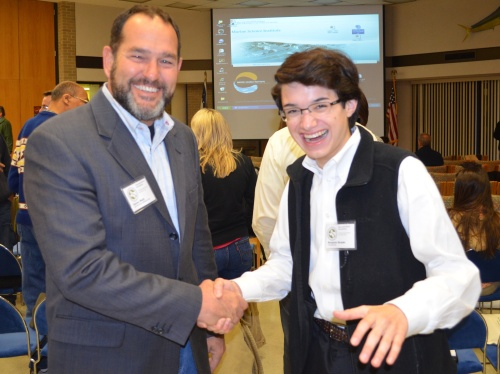 Dr. Damon Waitt and Commander Ben catch a moment together at the Invasive Plant and Pest Conference