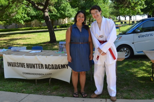 Commander Ben and Phoebe Anne Romero meet in front of the Invasive Hunter Academy before Earth Day festivities