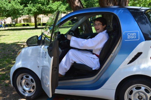 Commander Ben trying out Car2Go's electric car at St. Edwards University