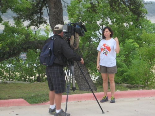 Sarah Richards being interviewed by KVUE about the Lake Travis Cleanup event