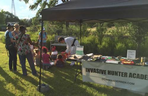 The young Austin naturalists found a great spot near the academy table to sample invasive plant species and work on their Invasive Hunter action diorama.